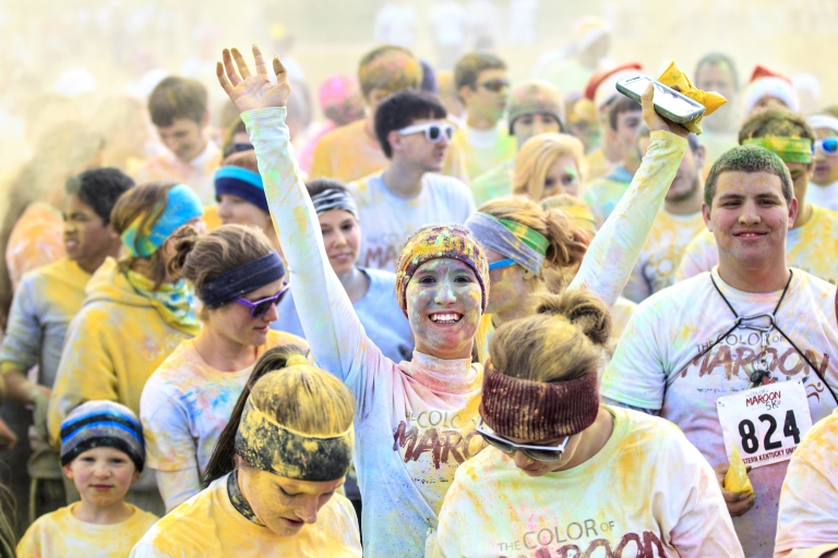 Students covered in powder color